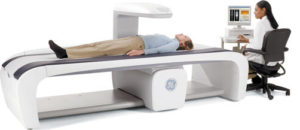 patient laying on table while having a DEXA scan
