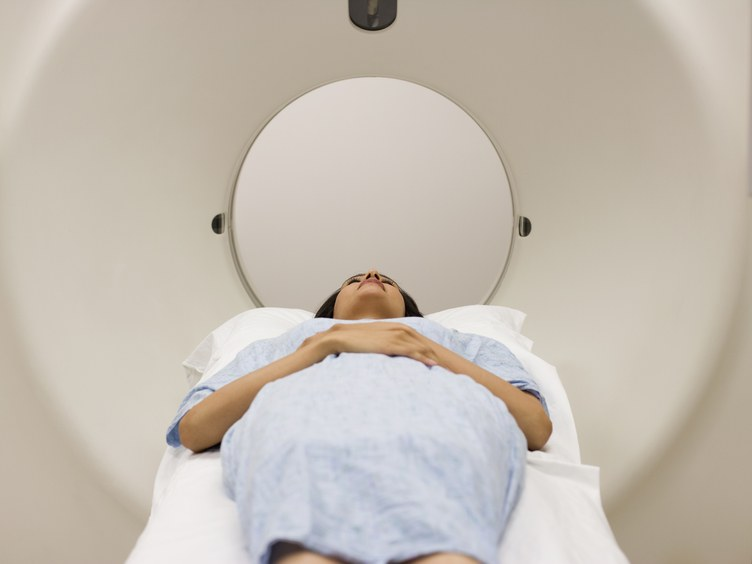 Patient laying on MRI table about to have an MRI scan