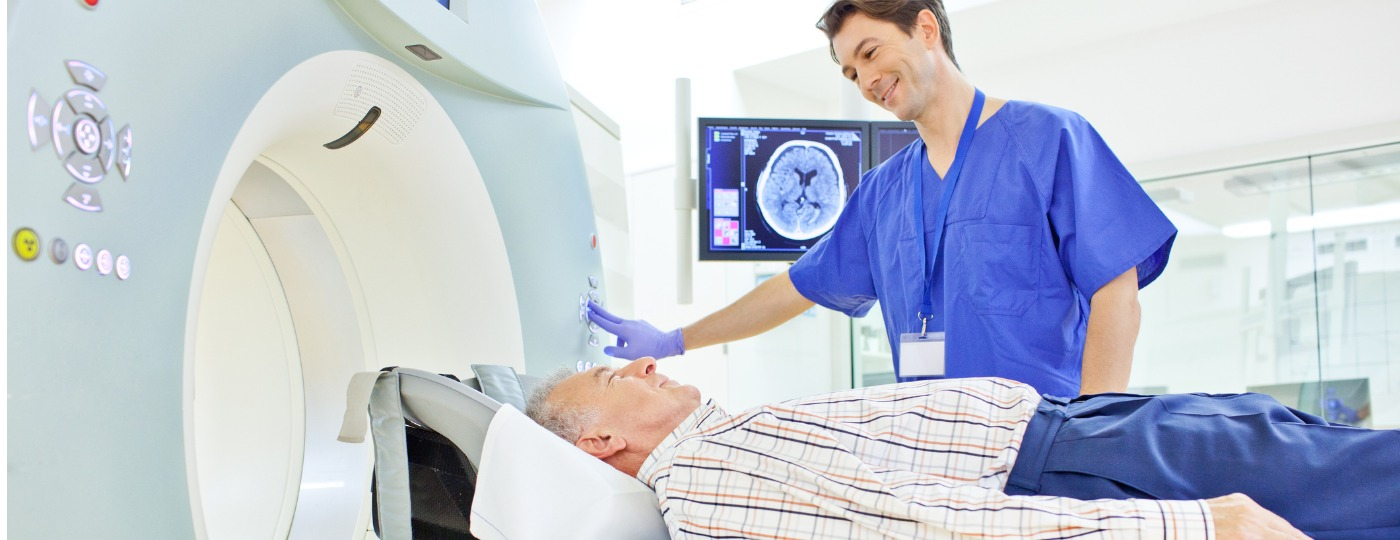 CT Tech talking to patient about exam
